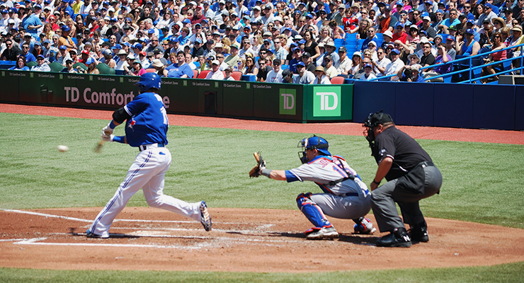 Blue Jays outfielder Jose Bautista makes contact at the Rogers Centre. (Photo via James G. on Flickr.)
